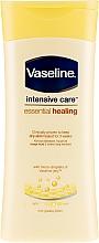 Düfte, Parfümerie und Kosmetik Feuchtigkeitsspendende Heillotion für sehr trockene Körperhaut - Vaseline Intensive Care Essential Healing Lotion