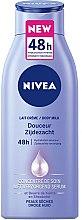 Düfte, Parfümerie und Kosmetik Feuchtigkeitsspendende Körpermilch mit Sheabutter - Nivea Douceur Zijdezacht Body Lotion