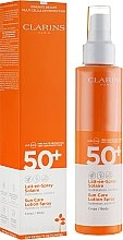 Düfte, Parfümerie und Kosmetik Cremige Sonnenschutzspray SPF 50+ - Clarins Lait-en-Spray Solaire Corps SPF 50+